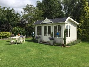 summerhouse, garden room, fun, cream, blinds, planting, lavender, candles, seating